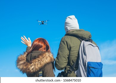 Two couple taking a selfie with a drone, drone navigating