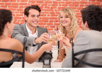 Two couples providing
