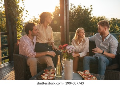 Two couples socializing on terrace together