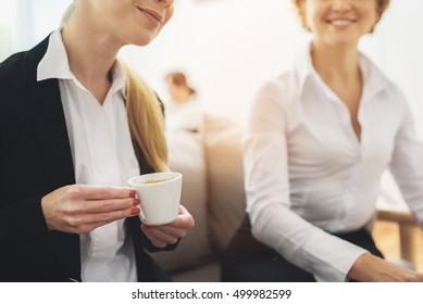 Two coworkers having coffee break
