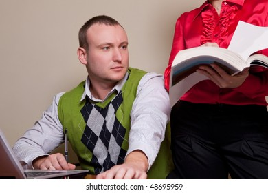 Two coworkers interacting at workplace