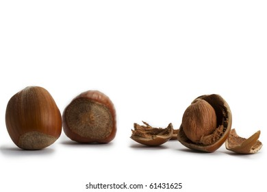 two and a cracked hazelnut on white background