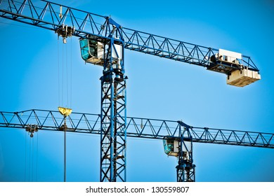 Two cranes and blue sky
