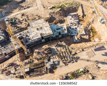 two cranes working on big construction site. aerial view