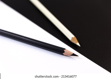 Two Crayons in black and white with black and white background.