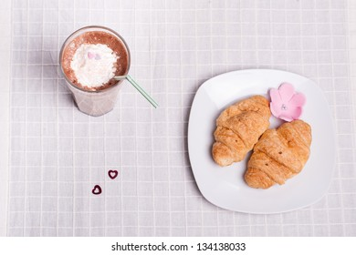 two croissant and one coffee at breakfast