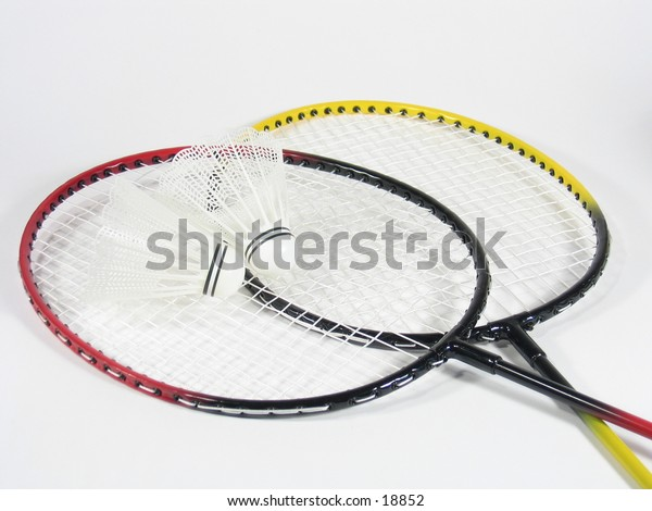 Two crossed badminton raquets with shuttlecocks.