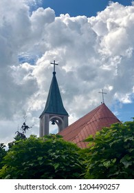 Two crosses are visible on top of a Christian church and a bell tower in Rzeszow, Poland.