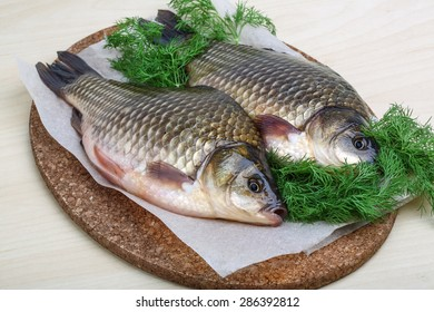 Two crucian with dill ready for cooking