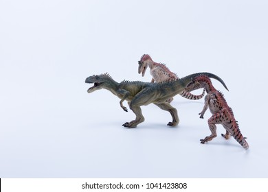 Two Cryolophosaurus dinosaur in attack position for a allosaurus with white background