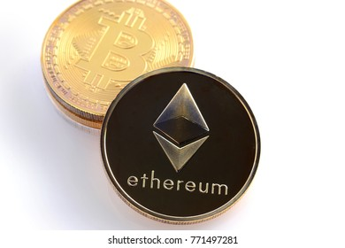 Two cryptocurrencies on a light surface