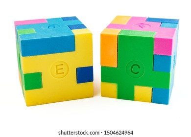 Two cube puzzle of multi-colored rubber shapes. Concept of decision making process, creative, logical thinking. Logical tasks. Conundrum, find the missing piece of the proposed.