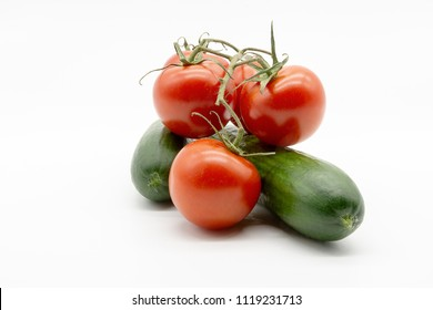 two cucumbers and five tomatoes
