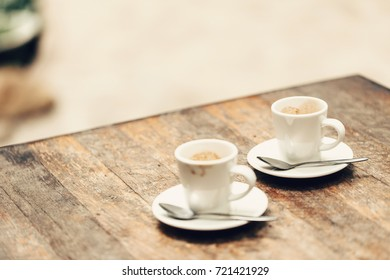 two cup of espresso on wood table in cafe or coffeeshop.
