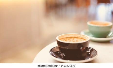two cup of finished hot coffee left on table in cafe with copy space on left, vintage tone