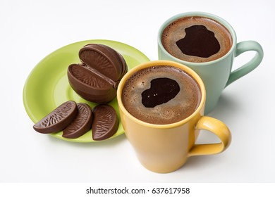 Two cups of coffee and chocolate.