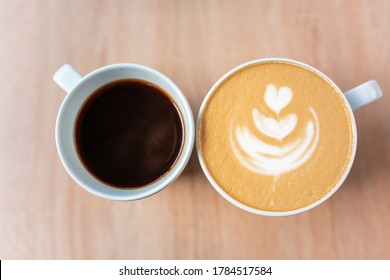 Two cups of coffee, different choice: black or white, espresso or capuchino, americano or latte. Different tastes in coffee concept.