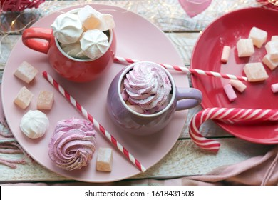 Two cups of coffee with meringues and marshmallows, Turkish delight on a plate, hearts, illumination, against the background of a window, homeliness, Valentine's day, romantic greeting, happy birthday