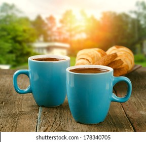 two cups of coffee in morning garden