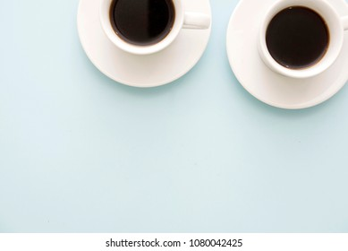 two cups of coffee on pastel blue table in minimal style, Top view. business team work meeting concept