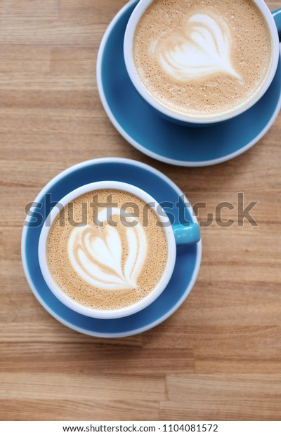 Two cups of coffee on the table. View from above