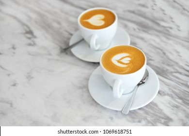 Two cups of coffee on white background