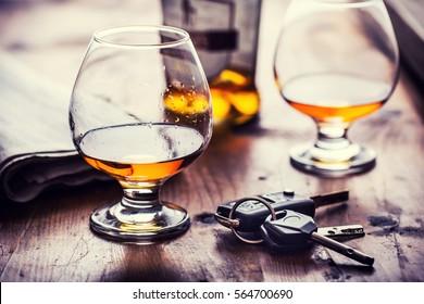 Two cups of cognac brandy or rum with car keys.