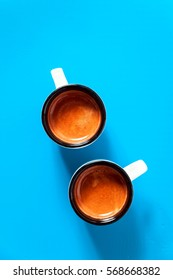 Two cups of espresso coffee on Deep Sky Blue background