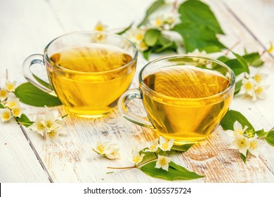 Two cups of herbal tea on wooden grunge table