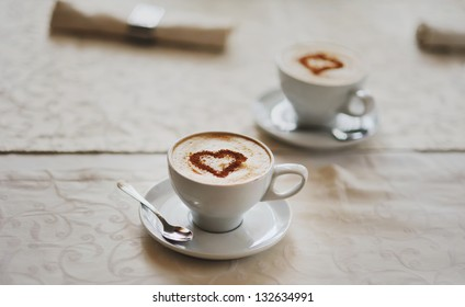 two cups of Hot Chocolate on a table