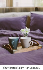Two cups with morning coffee and flowers