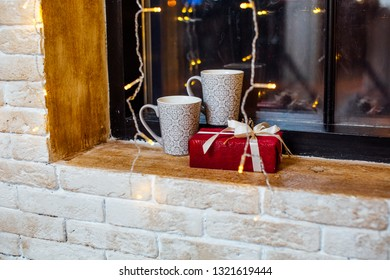 two cups on the windowsill