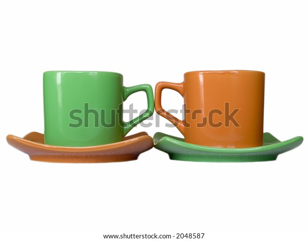 two cups with saucers orange and green