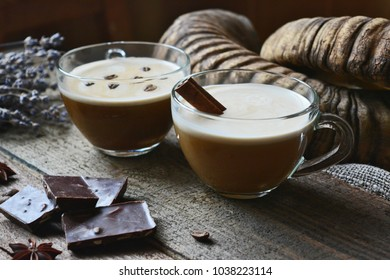 Two cups o? spicy coffee with cream and cinnamon