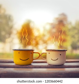 Two cups of tea on nature background