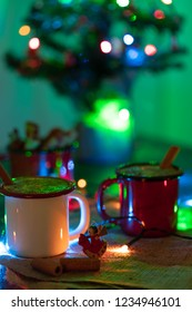 Two cups of Turkish salep (milky traditional hot drink) with chiristmas lights on sack fabric