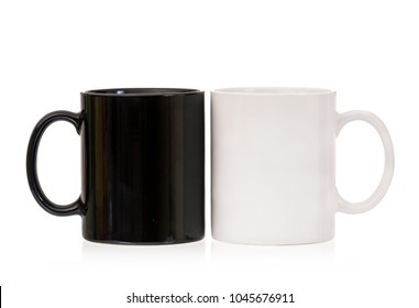 Two cups - white and black, isolated on white background