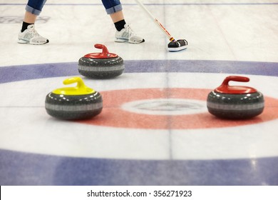 A two curling stone on the ice of a curling rink