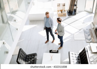 Two customers entering interior design store