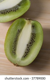 Two cut fresh kiwi are placed on the table.