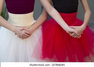Two cute ballerinas getting ready for their recital