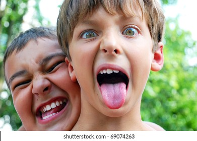two cute boys making crazy faces outdoor