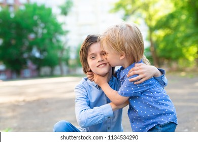 two cute brothers hug and fool around in the yard