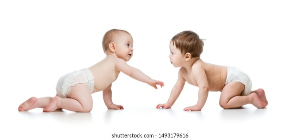 Two cute children looking at each other. Babies weared diaper. Infants isolated on white