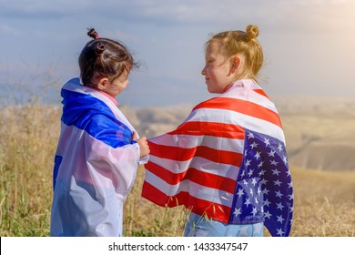 Two cute girls with American and Israeli flags.Two nations one heart concept.America–Israel Friendship.