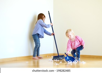 Two cute girls helping her mom to clean up
