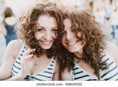 Two cute girls smiling twins