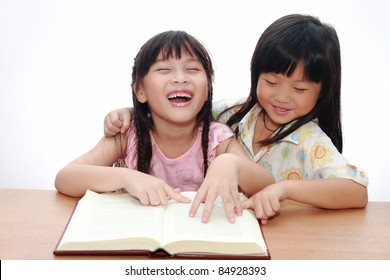 Two Cute little asian girl happy reading book