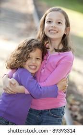 Two cute little girls hugging