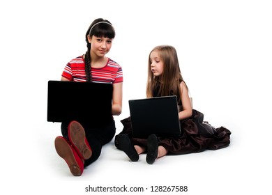 two cute little girls with laptops